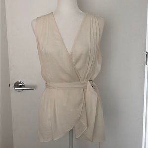 Sleeveless belted top with pleated details